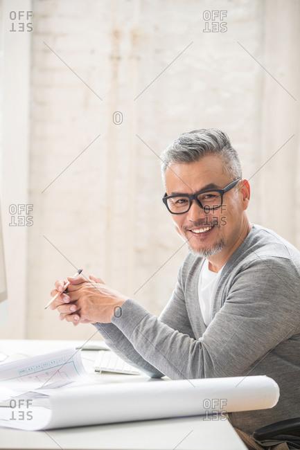 Senior designer in his office
