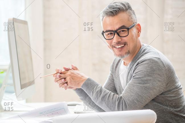 Senior designer sitting at his desk