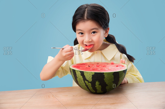 The little girl eating watermelon