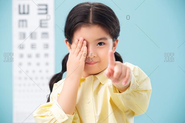 The little girl testing her eye sight