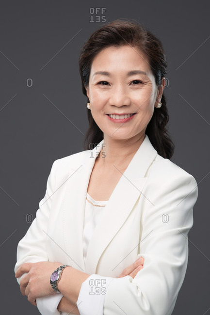 Elegant mature business lady in white