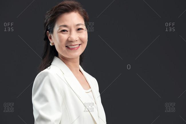 Portrait of smiling, confident woman