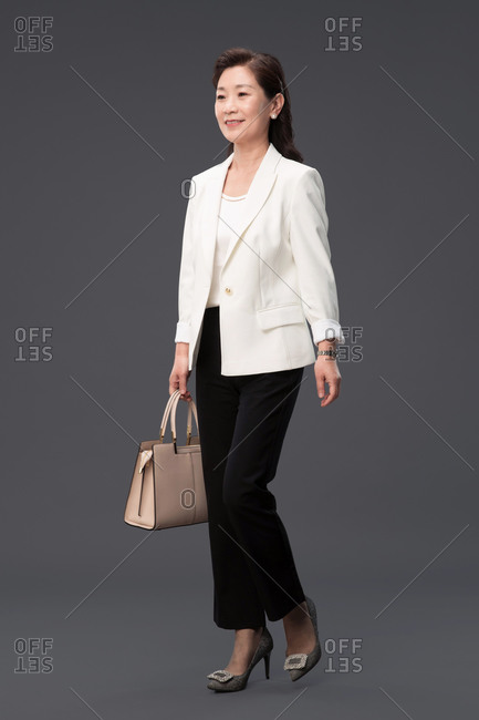 Portrait of a businesswoman carrying a bag