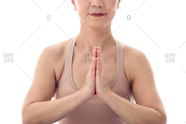 Hands folded yoga middle-aged women part features