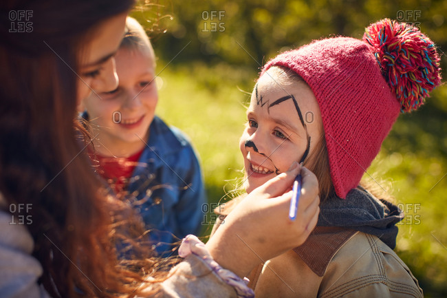 Girl getting face painted for fun