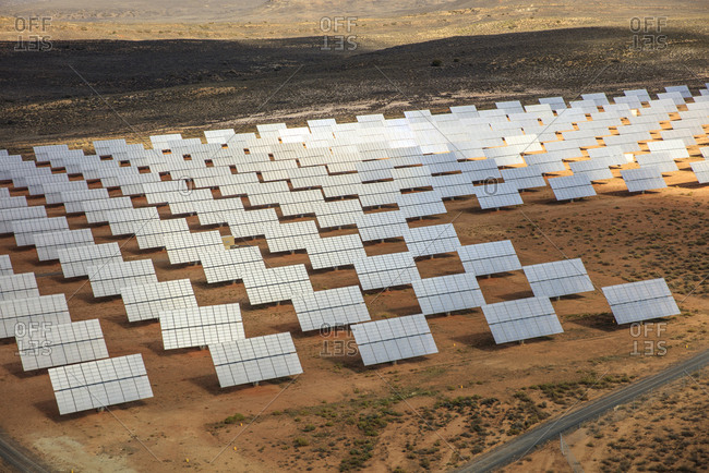 Rows of solar panels in arid landscape, aerial view, Cape Town, Western Cape, South Africa