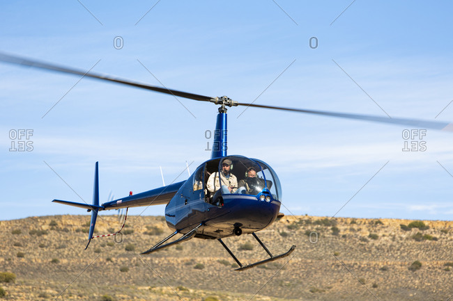 Helicopter flying above rural landscape, Cape Town, Western Cape, South Africa
