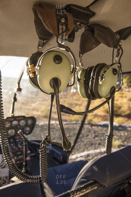 Helicopter interior with control panel and headphones, Cape Town, Western Cape, South Africa