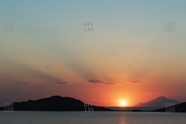 Scenic sunset over coastal mountains, Limnos, Khios, Greece