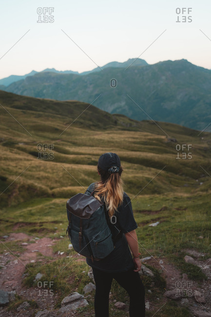 Young hiker admiring the beautiful hills of Aspe Valley in Pyrenees