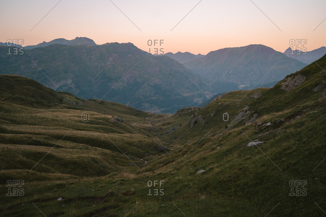 View of mountainous landscape from the top of Aspe Valley in Pyrenees during sunset