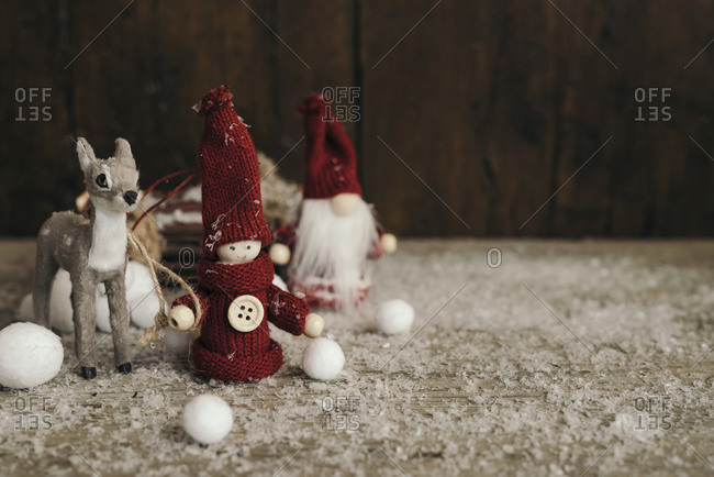 Scene of Santa Claus with a gnome and reindeer