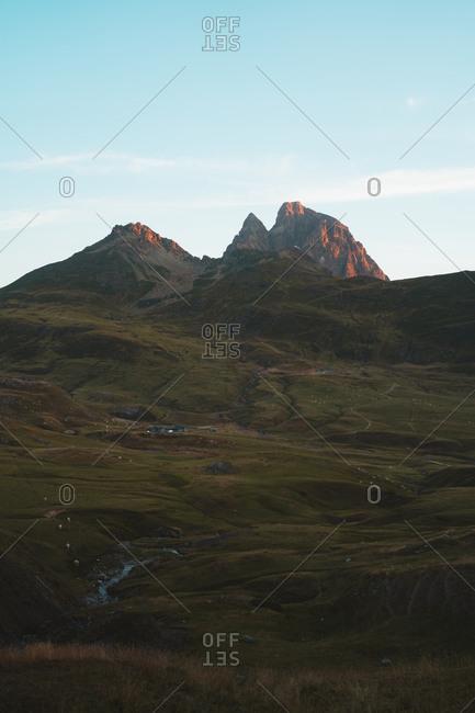Sunrise illuminating the summit of Pic du Midi in rugged French Pyrenees