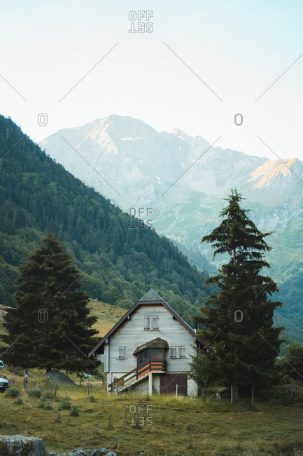 Wooden cabin between two pine trees in French Pyrenees