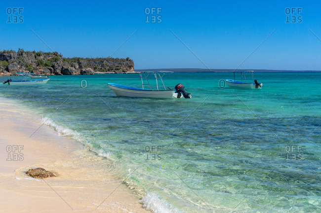 August 22, 2019: Greater Antilles, Dominican Republic, Pedernales, excursion boats glide in the turquoise waters of the Bahia de las Aguilas