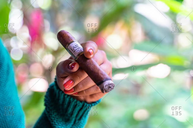 August 20, 2019: Greater Antilles, Dominican Republic, Jarabacoa, Los Calabazos, Sonido del Yaque Eco Lodge, woman holding cigar