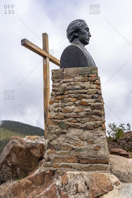 August 18, 2019: Greater Antilles, Dominican Republic, Jarabacoa, Manabao, Parque Nacional Jose Armando Bermudez, Pico Duarte, summit cross and Duarte bust on the summit of Pico Duarte
