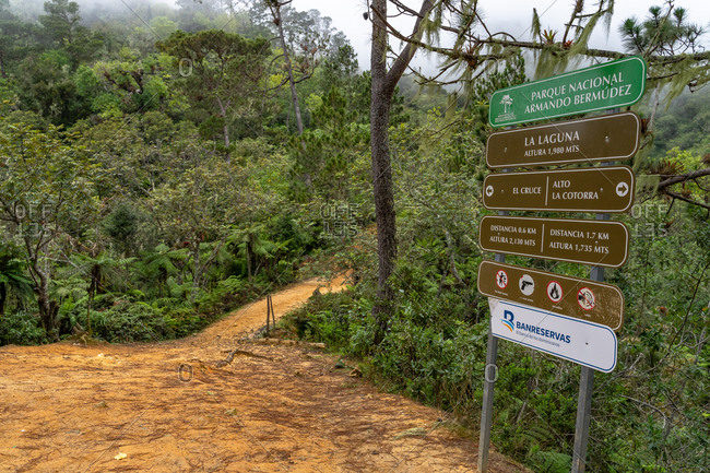 August 17, 2019: Greater Antilles, Dominican Republic, Jarabacoa, Manabao, Parque Nacional Jose Armando Bermudez, Pico Duarte, signs at the La Laguna break area ascending to Pico Duarte