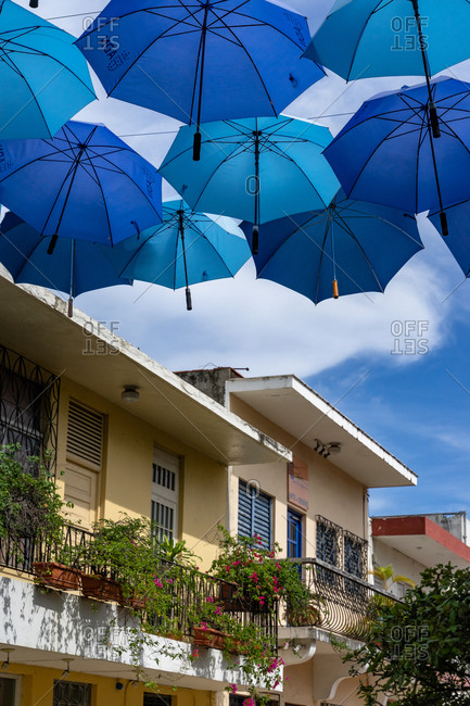 August 13, 2019: Greater Antilles, Dominican Republic, Santo Domingo, Decorative umbrellas on Calle Arzobispo Merino in the colonial district of Santo Domingo