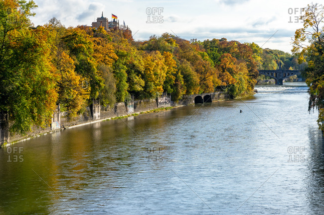 October 19, 2019: Europe, Germany, Bavaria, Munich, view from the Luitpold Bridge onto the autumnal Isar with the Maximilianeum hidden on the left bank