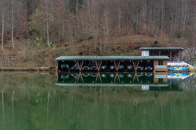 November 22, 2019: Europe, Germany, Bavaria, Bavarian Alps, Garmisch-Partenkirchen, boat house on autumnal Riessersee in Garmisch-Partenkirchen