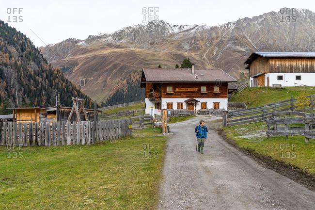 November 1, 2019: Europe, Austria, Tyrol, Stubai Alps, Sellrain, St. Sigmund im Sellrain, boy hikes through the Gleirschalm on the way to the Pforzheimer Hutte