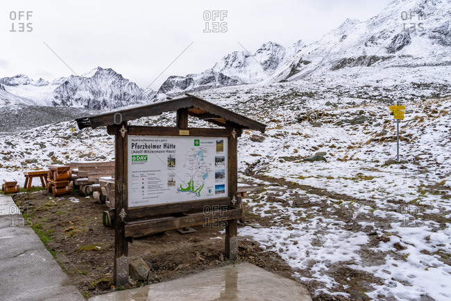 November 2, 2019: Europe, Austria, Tyrol, Stubai Alps, Sellrain, St. Sigmund im Sellrain, terrace of the closed Pforzheimer Hutte in front of an autumn mountain backdrop with first snow