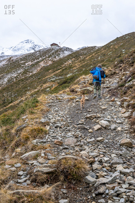November 1, 2019: Europe, Austria, Tyrol, Stubai Alps, Sellrain, St. Sigmund im Sellrain, boy on the ascent to the Pforzheimer Hut in the valley end of the Gleirschtal