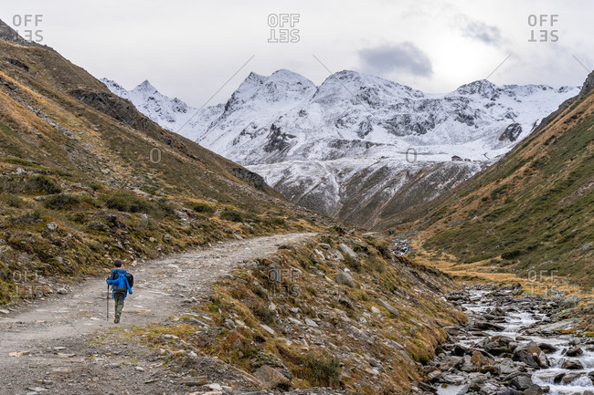 Europe, Austria, Tyrol, Stubai Alps, Sellrain, St. Sigmund im Sellrain, boy hikes along the Gleirschbach through the Gleirschtal towards Pforzheimer Hutte