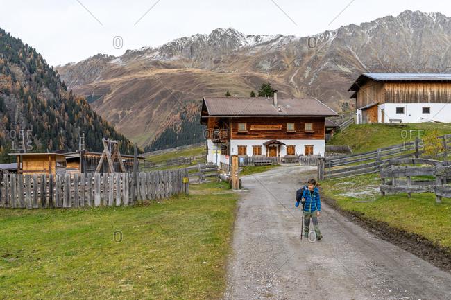 November 1, 2019: Europe, Austria, Tyrol, Stubai Alps, Sellrain, St. Sigmund im Sellrain, boy hikes through the Gleirschalm in the Gleirschtal