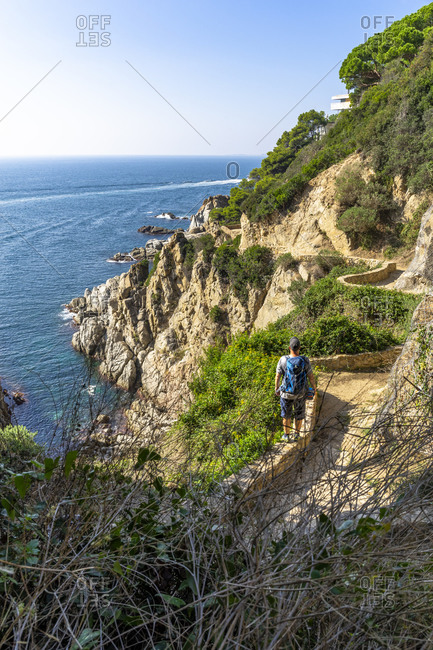 October 23, 2018: Europe, Spain, Catalonia, Costa Brava, Lloret de Mar, hikers on the Cami de Ronda long-distance hiking trail on the Costa Brava just before Lloret de Mar.