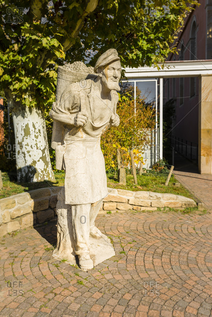 November 1, 2017: Winegrower sculpture at the entrance to the spa gardens in Bad Durkheim, next to the St. Ludwigskirche, Munich, Germany
