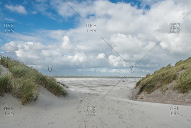 Dune passage with a view of the North Sea