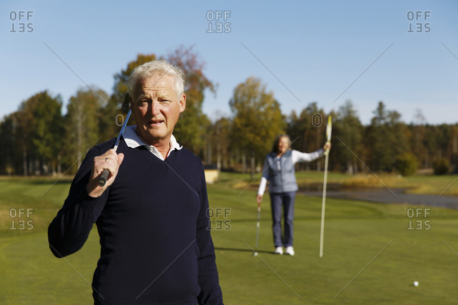 Man and wife on golf course