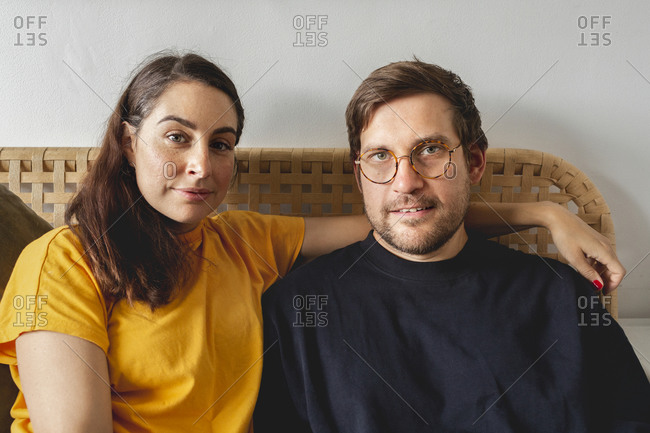 Mid adult couple together at home
