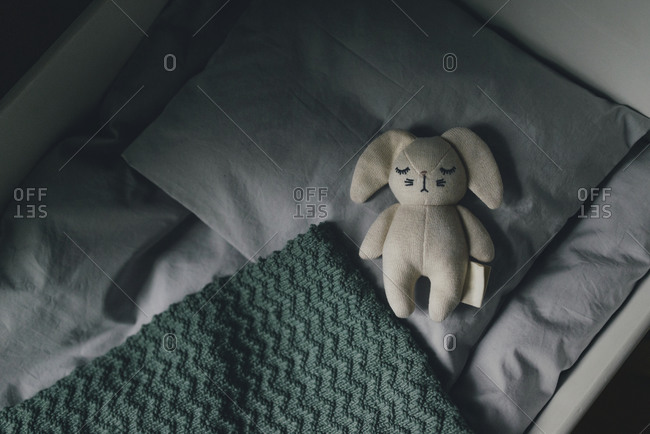 Stuffed toy in a cot