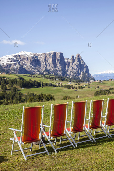 Row of loungers in mountains