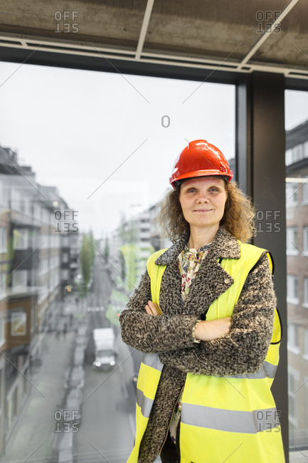 Portrait of female worker wearing hardhat