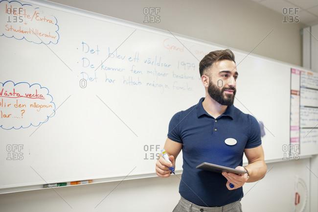 Teacher teaching in his classroom