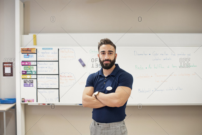 Portrait of teacher standing in classroom