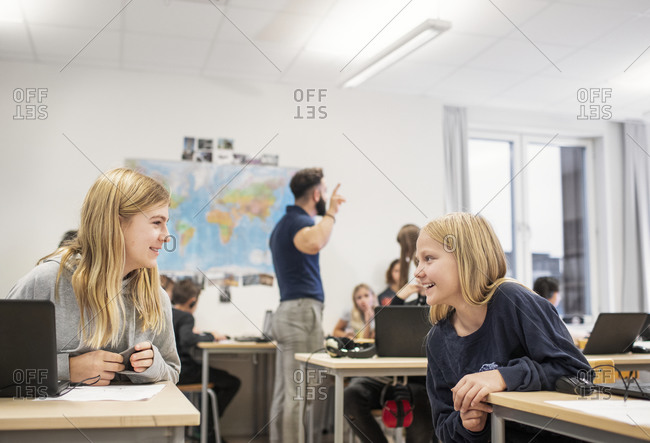 Girls in classroom talking together