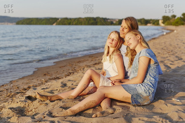 Mother with daughters on beach