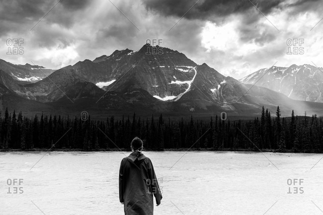 Person overlooking mountain landscape in black and white