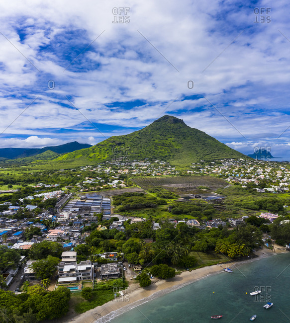 Mauritius- Black River- Tamarin- Helicopter view of coastal village with Tourelle du Tamarin mountain in background