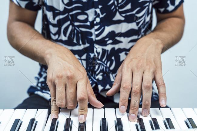 Man playing piano while sitting