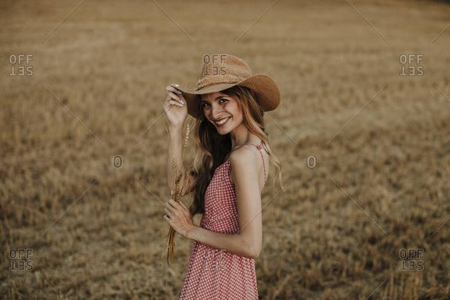 Woman smiling while standing at wheat farm