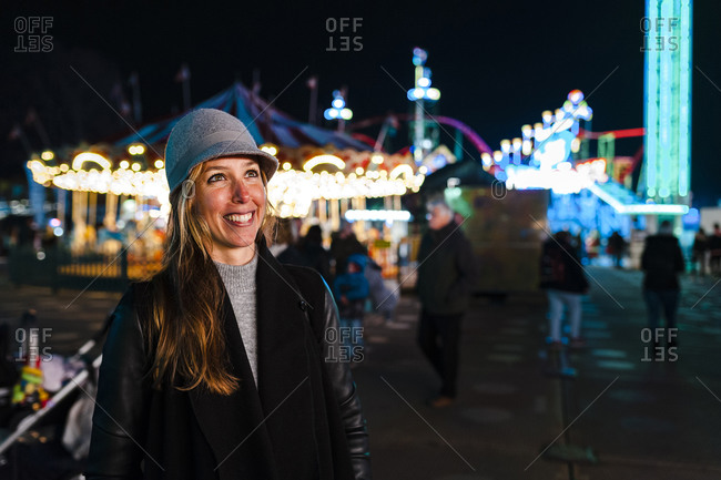 Smiling woman on fairground in winter