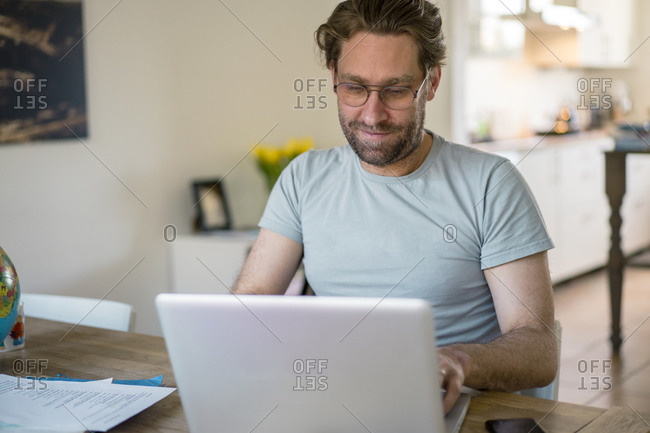 Freelancer using laptop in home office