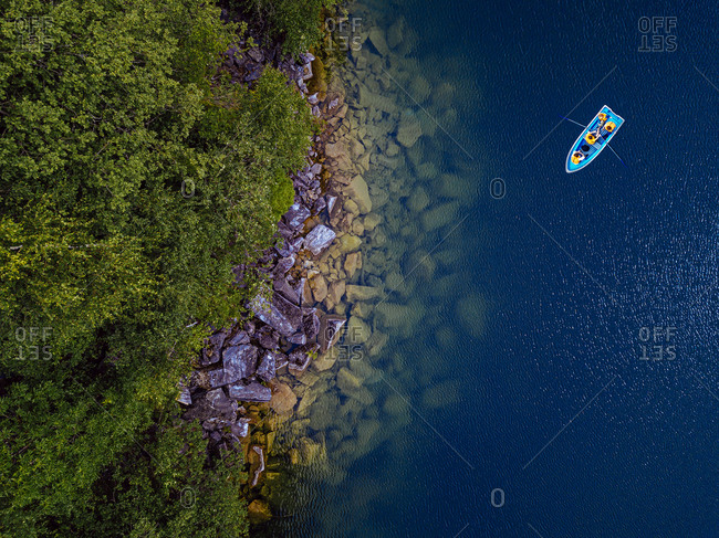 Aerial view of boat at rocky shore of Lake Light