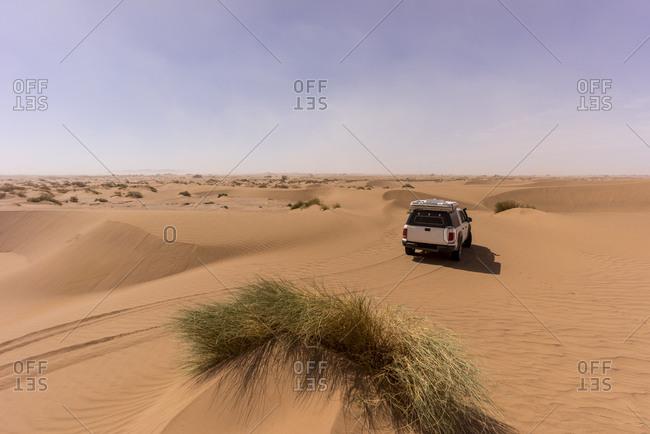 Off-roadcar in vast barren desert